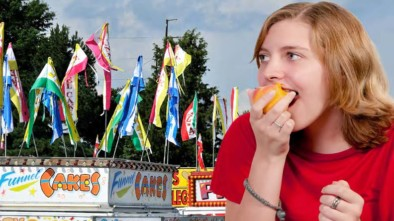 Woman eating candy apple